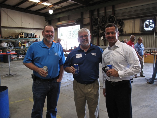 Standard's President, Greg Ryder, and guests pause for a photo op.