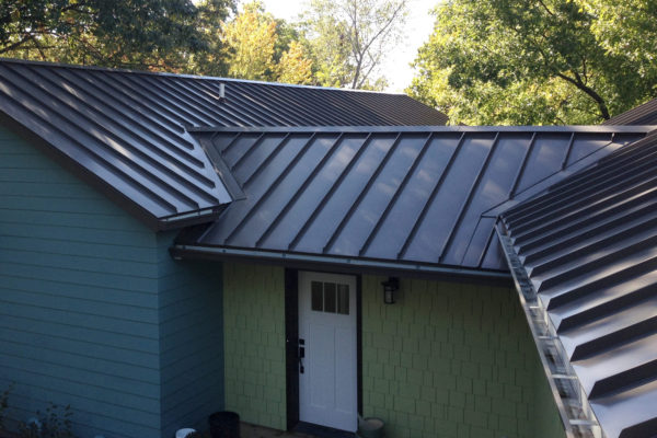 standing seam metal roof, gutters and down spouts